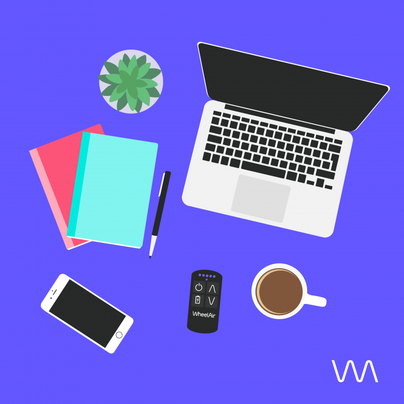 A laptop, WheelAir remote, phone, cup of coffee, notebook drawn on purple background.
